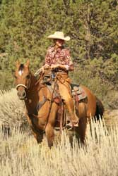 Photo of woman riding horse